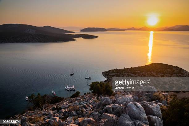 View from the top of the mountain at sunset over the sea. Dokos Island, Greece
