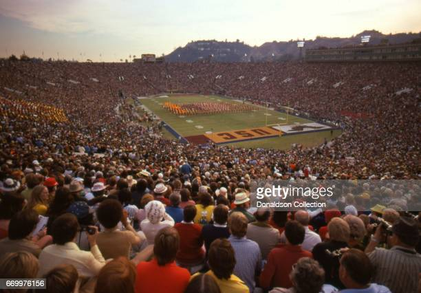 View from the top of the Rose Bowl as the Goodyear Blimp circles overhead with USC, University of Southern California, in big letters in the end zone...