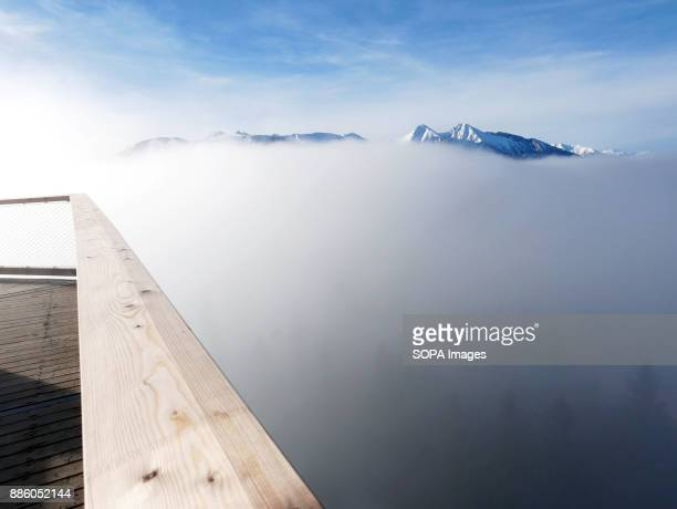 View from the top of the viewing deck the trees below and being covered by mist In Tatra mountains in Slovakia in Bachledova valley a treetop walk...