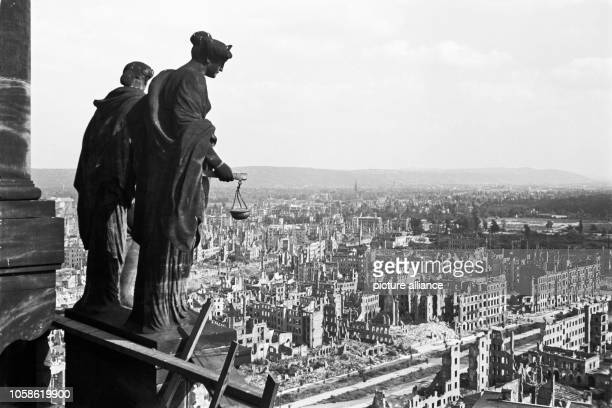 View from the Town Hall tower overlooking the destroyed innercity of Dresden On the left the allegorical figures justice and truth Date unknown Photo...