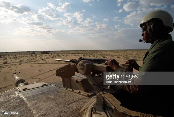 View from the turret of an American M1A1 Abrams tank part of the First Armored Division as a tank commander watched the horizon during a mechanized...