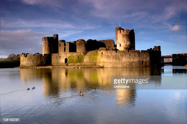 view from the water of caerphilly castle - castle stock photos and pictures