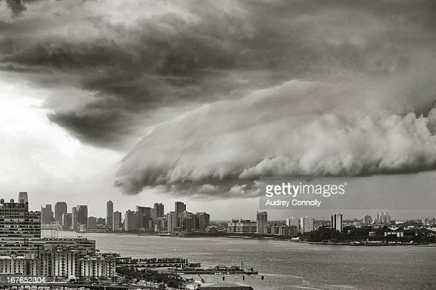 CONTENT] view from the westside of manhattan south towards Jersey City New Jersey and Chelsea Manhattan with large storm cloud approaching
