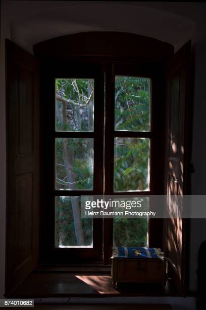 view from the window of an old house in monemvasia, peloponnese, greece - heinz baumann photography stock-fotos und bilder