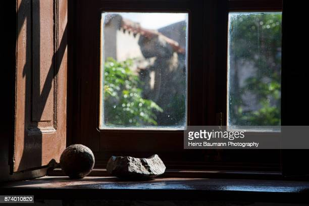 View from the window of an old house in Monemvasia with cannon ball from former times