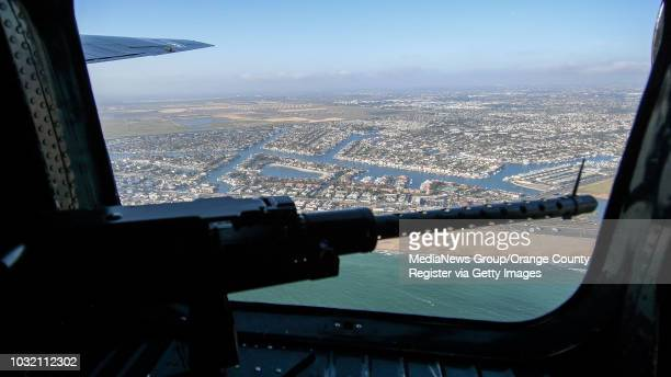 View from the window of Witchcraft a B24 Liberator as it flies past Huntington Harbor in Huntington Beach California on Friday May 12 2017