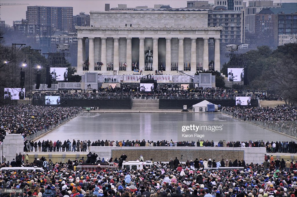 CONTENT] View from the World War II Memorial to the the Lincoln Memorial during the 2009 Barack Obama Inauguration Concert. The reflecting pool is iced over. Massive crowds are shown.