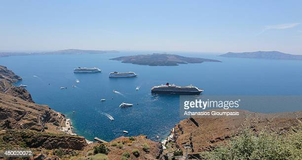 View from Thera caldera with views to the sea caldera volcano and cruise ships on June 30 2015 in Santorini GreeceThe traditional architecture of...
