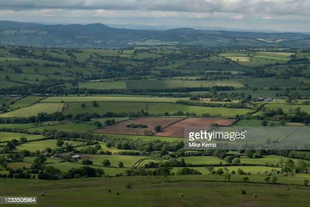 View from Titterstone Clee Hill across agricultural fields on 10th May 2021 in Titterstone Clee Hill, near Ludlow, Shropshire, United Kingdom....