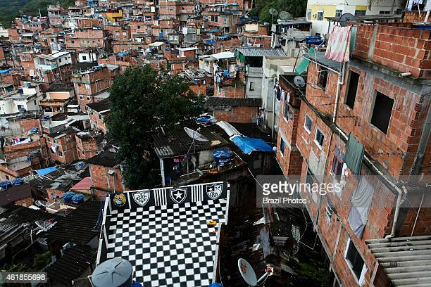 View from top of Favela Santa Marta a house´ slabcover used as recreational area painted with colors and symbol of Botafogo Football Club a famous...