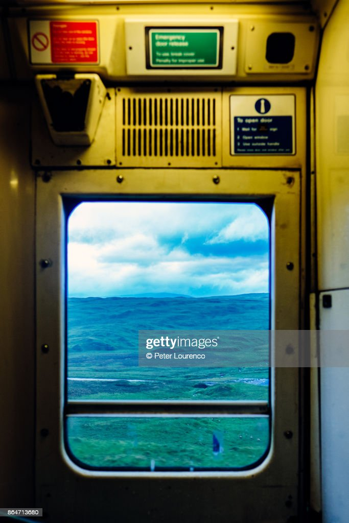 View from train window travelling through countryside. : Stock Photo