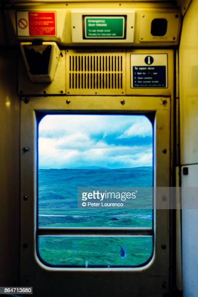 view from train window travelling through countryside. - peter lourenco stock pictures, royalty-free photos & images