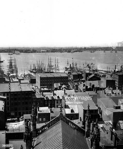 View from Trinity Church on Wall Street across the roof-tops to the docks and New Jersey shore. Built in 1846, Trinity Church was until the turn of...
