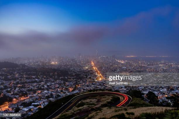 View from twin peaks on cloudy San Francisco skyline at sunset