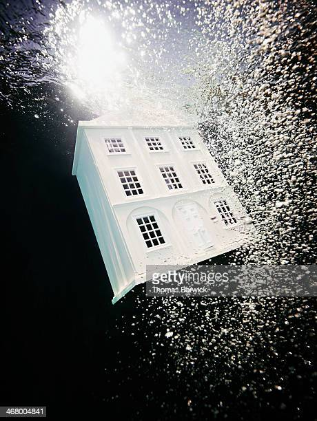 View from underwater of house sinking