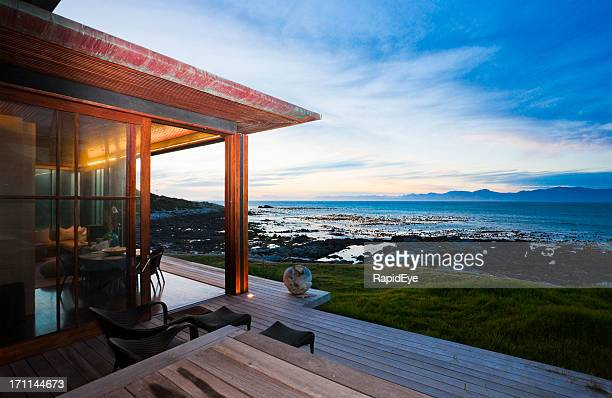 view from veranda of beach cottage over sea at sunset - chalet stock pictures, royalty-free photos & images