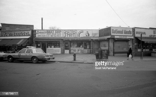 View from Veteran's Square park of various local businesses along 102nd Street in the Corona neighborhood of Queens New York New York April 13 1982...
