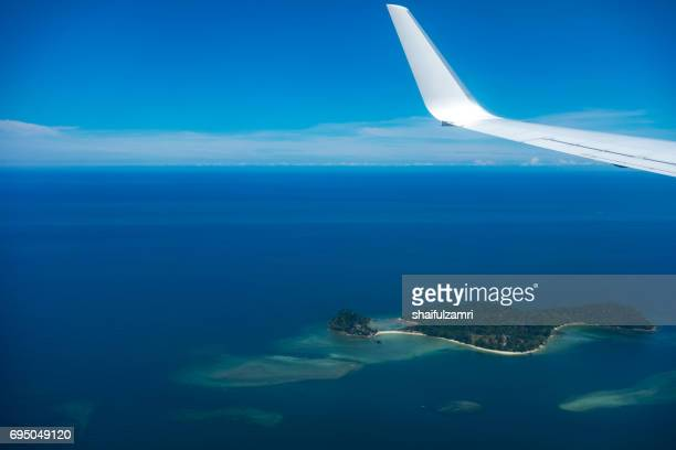 View from window of air-plane over tropical island