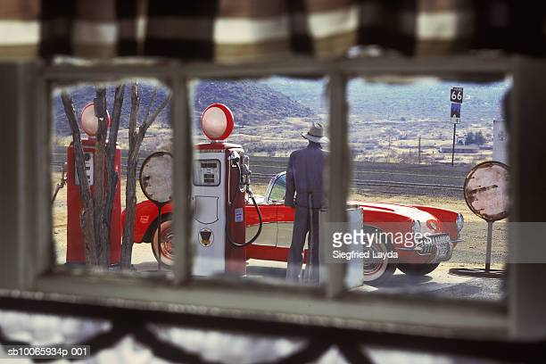 view from window of person standing at gas station (focus on background) - route 66 stock-fotos und bilder