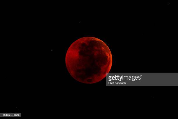 A view full moon during a 'blood moon' eclipse on July 28 2018 in Yogyakarta Indonesia Stargazers viewed Friday's total lunar eclipse which was the...