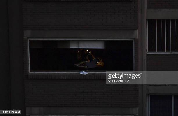 View in Caracas on March 26 during a power outage two weeks after a similar outage caused deaths and chaos Venezuela decreed a 24hour holiday Tuesday...