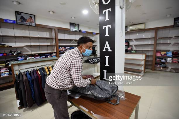 A view inside a clothing store as shops in the Shaheen Bagh market partially open after a gap of five months due to the anti CAA and NRC protests and...