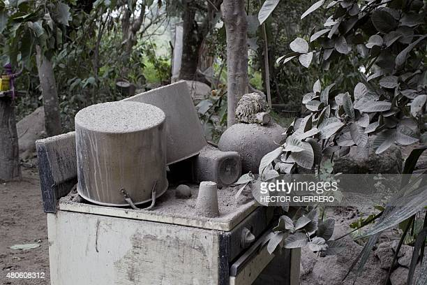 View inside a house covered by ash spewed by the Fire volcano in La Yerbabuena community Colima State Mexico on July 13 2015 following the eruption...