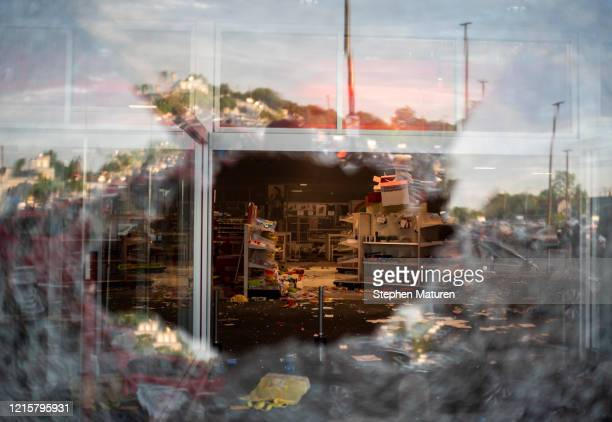 View inside a Target store through a broken window on May 27, 2020 in Minneapolis, Minnesota. Businesses near the 3rd Police Precinct were looted and...