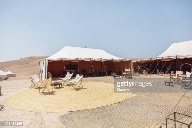 View inside a tourist camp with tents, chairs and fire place. Moroccan desert near Marrakesh, Morocco.