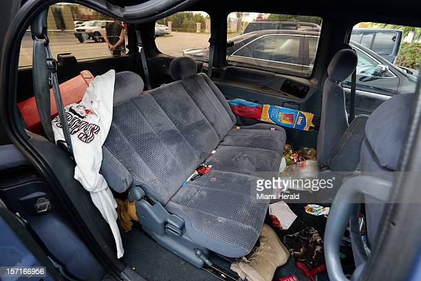 View inside Nissan Quest SUV, Thursday morning, November 29 is the scene of an apparent murder/suicide where a father, his 6-year-old daughter and a...