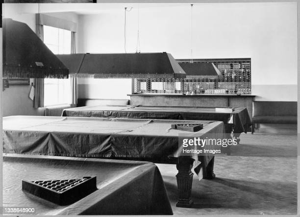 View inside the 'Esso' Social Centre at Fawley showing billiard tables and a bar on the far wall. This image was catalogued as part of the Breaking...