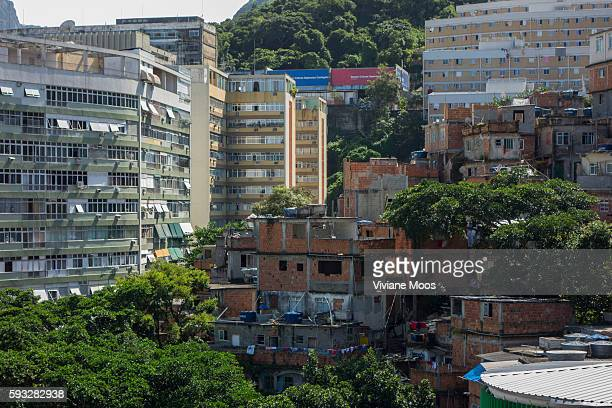 View inside the favela Cantagalo looking at the top of the hill New high rises for living apartments and construction surround the old traditional...