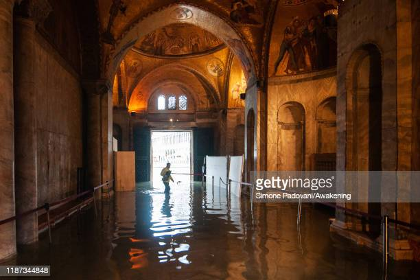 A view inside the flooded Basilica of St Mark during an exceptional high tide on November 13 2019 in Venice Italy Venice's second highest tide after...