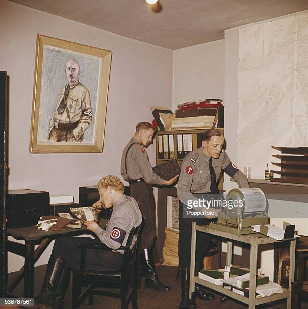 View inside the headquarters of the National Socialist Movement a far right neonazi group in London with one member of the group printing leaflets on...