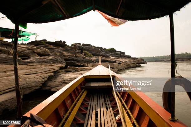A view inside the longtail boat on the bank of Mekong river