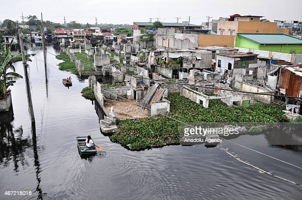 A view inside the submerged residential compound at Artex in Malabon City North of Manila on Sunday The compound has been submerged to flood waters...