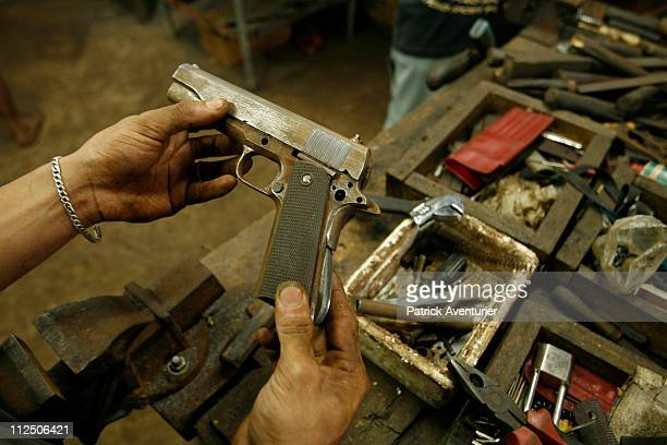 A view inside the WORLD gun manufacturing cooperative where a worker is making a 45mm semiautomatic handgun similar to a Beretta The local...