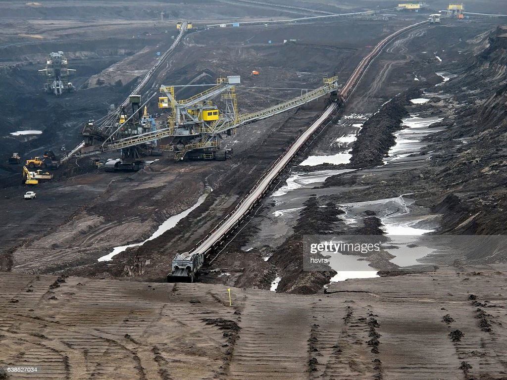 view into coal mine with machines and conveyor belt : Stock Photo