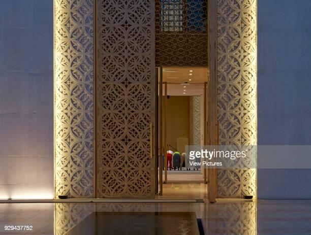 View into mosque through gold doors during prayers Jumaa Mosque Doha United Arab Emirates Architect John McAslan Partners 2017