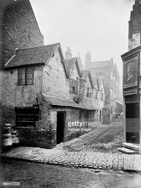A view into Queen's Head Yard in Birmingham which is badly rundown The photograph was possibly taken in the nineteenth century as there is a cart...