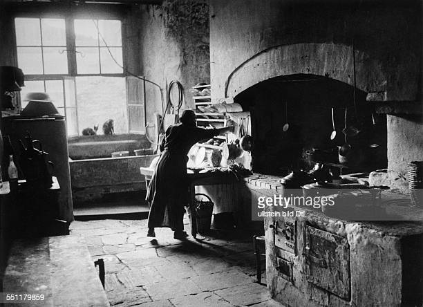 View into the kitchen of the monastery Iviron. Brother Filaretos makes lunch. Athos, Monastic Republic By Claude Jacoby