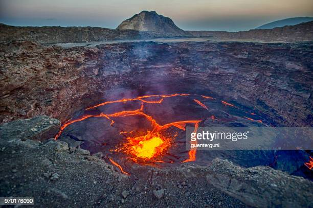 view into the lava lake of erta ale volcano, ethiopia - volcano stock photos and pictures