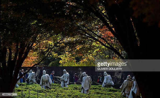 A view is seen of the statues from the Korean War memorial on Veterans Day as visitors pay their respects to the soldiers who took part in the war on...