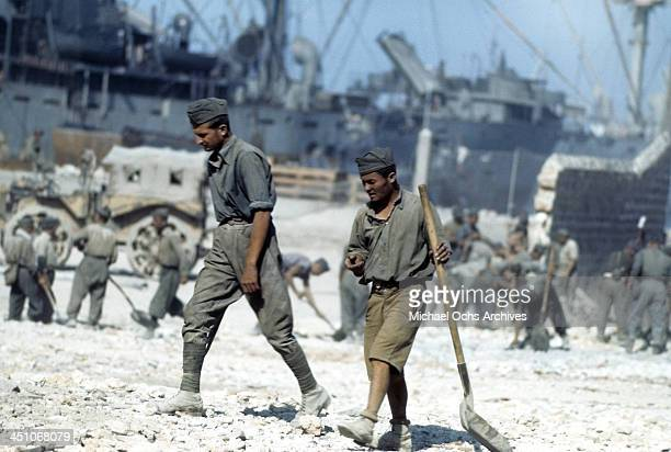 A view Italian POW's clean the rubble 5 days after winning the campaign and the invasion of Sicily called Operation Husky during the World War II in...