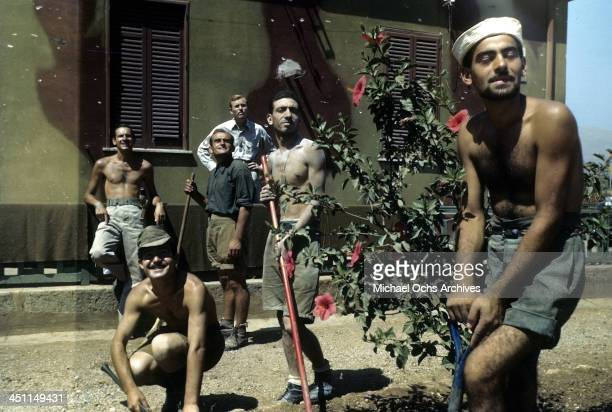 A view Italian POW's cleaning the garden after the Allied force invasion of Sicily 5 days after winning the campaign called Operation Husky during...