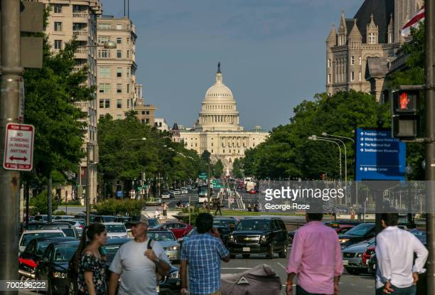 A view looking at the Capitol down Pennsylvania Avenue is seen on June 4 2017 in Washington DC The nation's capital the sixth largest metropolitan...