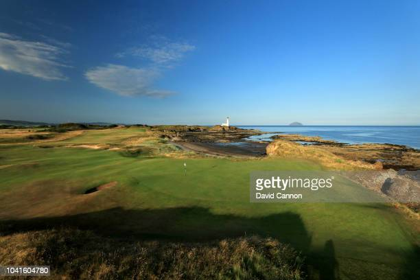 A view looking back to the Turnberry Lighthouse and the island of Ailsa Craig from behind the green on the par 5 10th hole on the Ailsa Course at the...