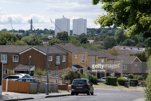 View looking down across terraced housing from Balsall Heath towards tower blocks of high rise flats in Edgbaston on 3rd August 2020 in Birmingham...
