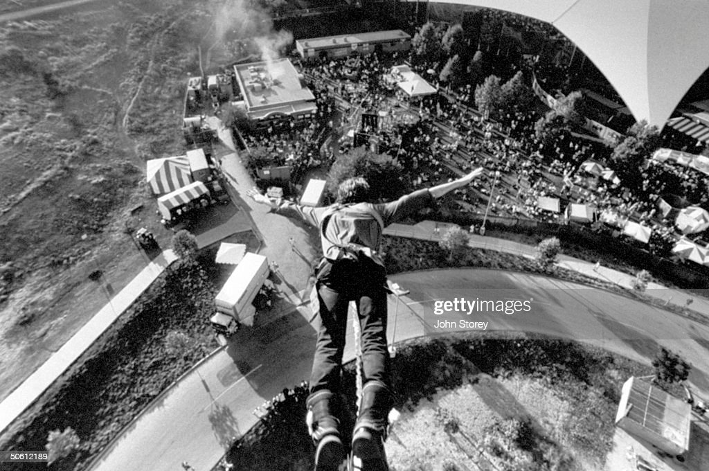 View looking down on a bungee jumper as : News Photo