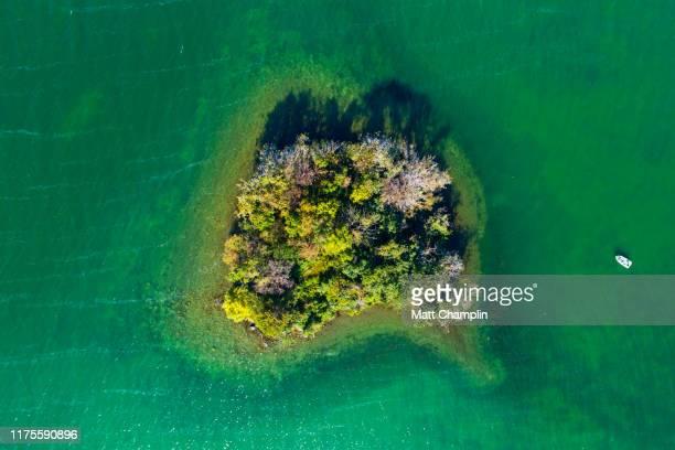 view looking down on island in blue lake - lake auburn - fotografias e filmes do acervo